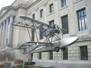 First ever stainless steel plane in front of Benjamin Franklin Institute.